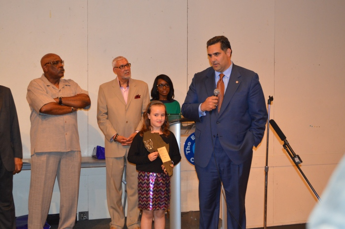 Rich Negrin winning an Essence of Fatherhood Award
