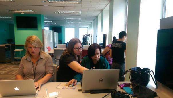 Karissa Demi (center) assist City employees during the HTML course.
